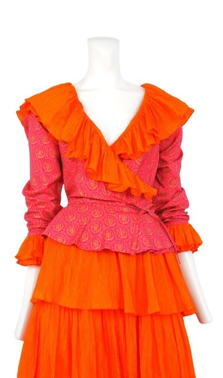 Bright orange and fuchsia silk two piece. Wrap blouse with decorated with YSL ruffles and long maxi tiered skirt.