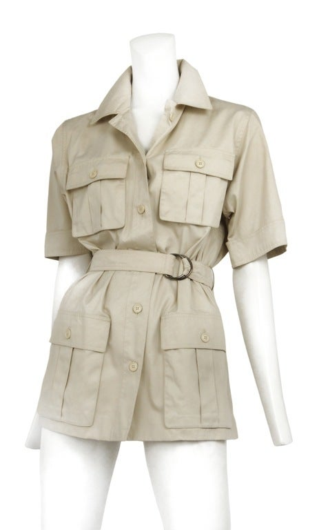 Khaki cotton twill safari tunic shirt. Button front placket, four gusseted patch pockets and waist belt with D ring closure.