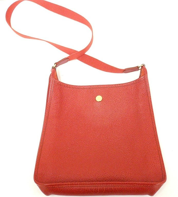 Discontinued style in vibrant leather with iconic Chaine d'Ancre closure!  **Please note, colors can vary from monitor to monitor. This is a cool (blue undertone) red, close to lipstick, but not VERY bright.   This bag is in NEAR MINT condition.