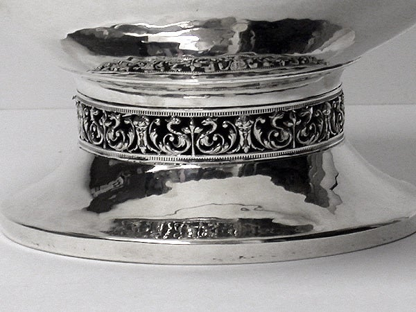 A. E. Jones Arts & Crafts silver hammered design large bowl, Birmingham 1920 by A. E. Jones. The bowl on circular plain hammered base with arabesque eastern surround frieze, plain ovoid hammered body and upper frieze surround conforming. Stamped on