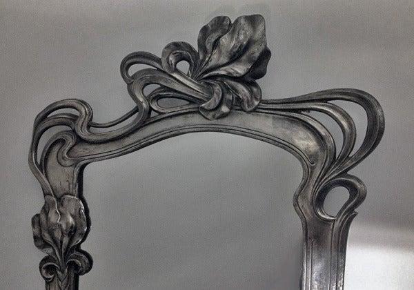 Art Nouveau pewter Mirror, attr Argentor, Austria C.1900. The mirror of floral design, original easel and back. Height: 52 cm. Width: 32 cm. For attribution Ref: Christies, London SK, Nov 7, 2007, Lot 159 Sold US$1,962.