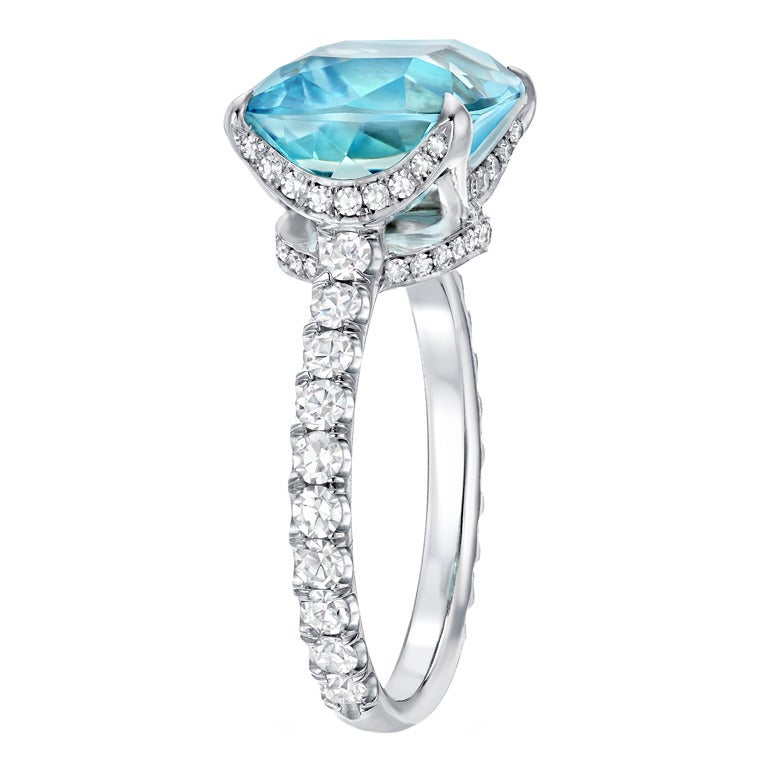 A very fine 5.11ct cushion cut Aquamarine, set in a 0.85ct total, classic diamond ring.  Hand made in Platinum in the USA. Finger size 6. Re-sizing is complimentary upon request. Signed Tamir.