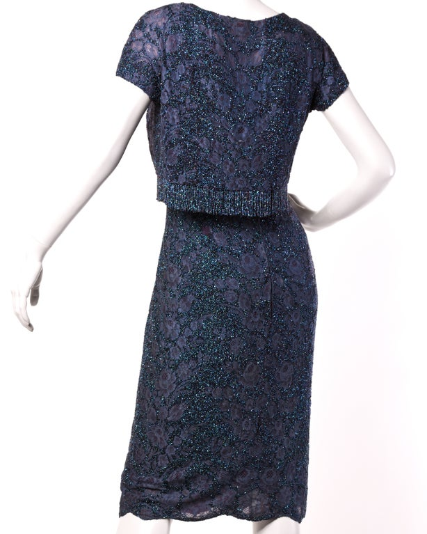 Spectacular two-piece dress and jacket set by Italian couture house Mingolini Gugenheim. Both pieces are meticulously hand beaded with tiny sparkling steel cut seed beads in shades of ink blue. The jacket is lined in mesh and features hand beaded