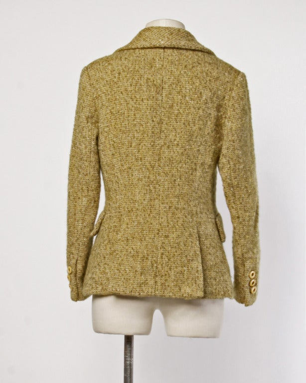 Tailored mustard tweed wool jacket by Guy Laroche Colelction. Button up front, notched collar, and flap pockets. Fully lined.  DETAILS:  Fully lined Front button closure Circa: 1990s Label: Guy Laroche Marked Size: 10 Estimated Size:
