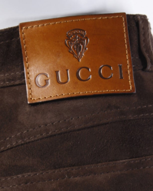 Luxurious soft brown suede leather high waisted pants by Gucci. Traditional 5 pocket design with embroidered Gucci logos on both back pockets.   Details  Fully lined  Front zip and button closure Front pockets Back pockets Circa: