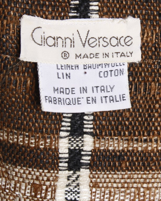 Unique brown and beige plaid oversized blazer jacket by Gianni Versace in a linen/ cotton blend. Made in Italy.  Details  Unlined Front button closure Circa: 1980s Label: Gianni Versace Estimated Size: M-L Colors: Brown / Taupe / Chocolate