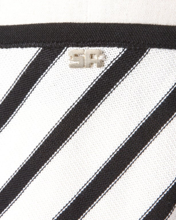 Black and white chevron striped knit skirt by Sonia Rykiel. Classic and chic.  Details  Unlined Elastic Waistband Circa: 1990s Label: Sonia Rykiel Marked Size: 42 Estimated Size: M Colors: Ivory / Black Fabric: 100%