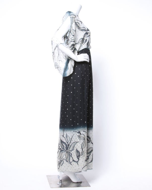 Stunning silk chiffon maxi dress with split batwing sleeves and ombre/ floral hand painted design that is embellished with tiny sparkling sequins. Absolutely amazing piece!  Details  Fully Lined Back Zip and Hook Closure Circa: