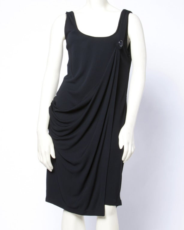 Amazing and collectible 1990s asymmetric black dress by Gianni Verace Couture. Iconic Medusa button on one shoulder and Grecian style draping. A rare piece!