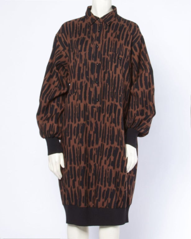 Gorgeous brown and black printed wool shirt dress by Guy Laroche. Banded knit sleeve cuffs and bubble hem. Structured collar and button up front.  Details  Unlined Front Button Closure Front Pockets Side Pockets Circa: 1980s Label: Guy