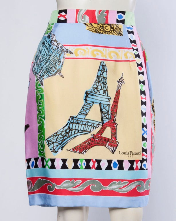 Incredible resort scarf print silk jacket and skirt set by Louis Feraud. Colorful border print includes tourist destinations such as the Eiffel Tower. Both pieces are constructed entirely of medium weight silk and the jacket features signed buttons.