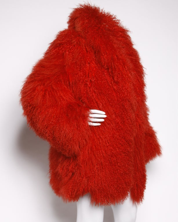 """Amazing oversized red dyed genuine Tibetan or Mongolian lamb fur jacket that looks like it jumped right off the catwalk. Long soft shaggy fur. Side pockets. Fully lined. No closure, hangs open.  Measurements:  Bust: 48"""" Sleeve Length:"""