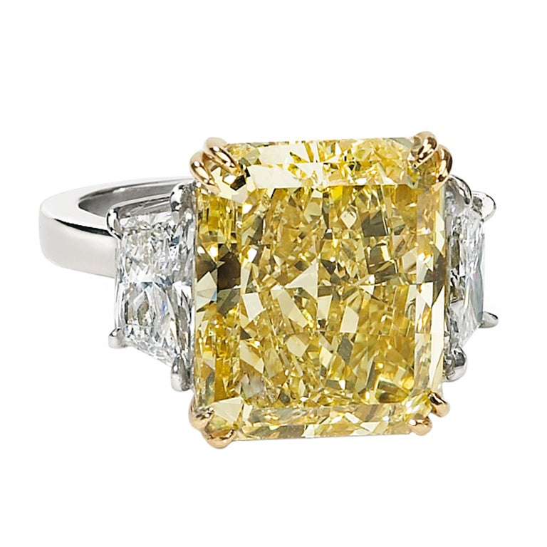 A Fancy Yellow 14.42ct Radiant Cut Diamond GIA Cert Ring