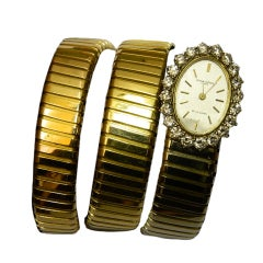 BULGARI A Lady's Three-Color Gold and Diamond Tubogas Watch