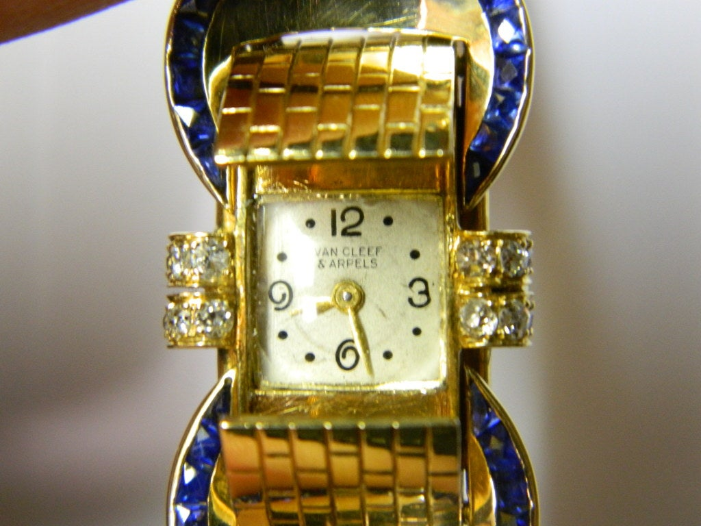 A sophisticated bracelet watch, manufactured by Van Cleef & Arpels in the late 1940s, presenting small diamonds and sapphires on an 18k yellow gold mounting. The watch is functioning and carries a Van Cleef movement.