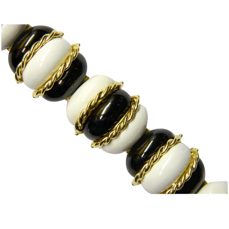 A Sophisticated Black & White Enamelled Gold Bracelet