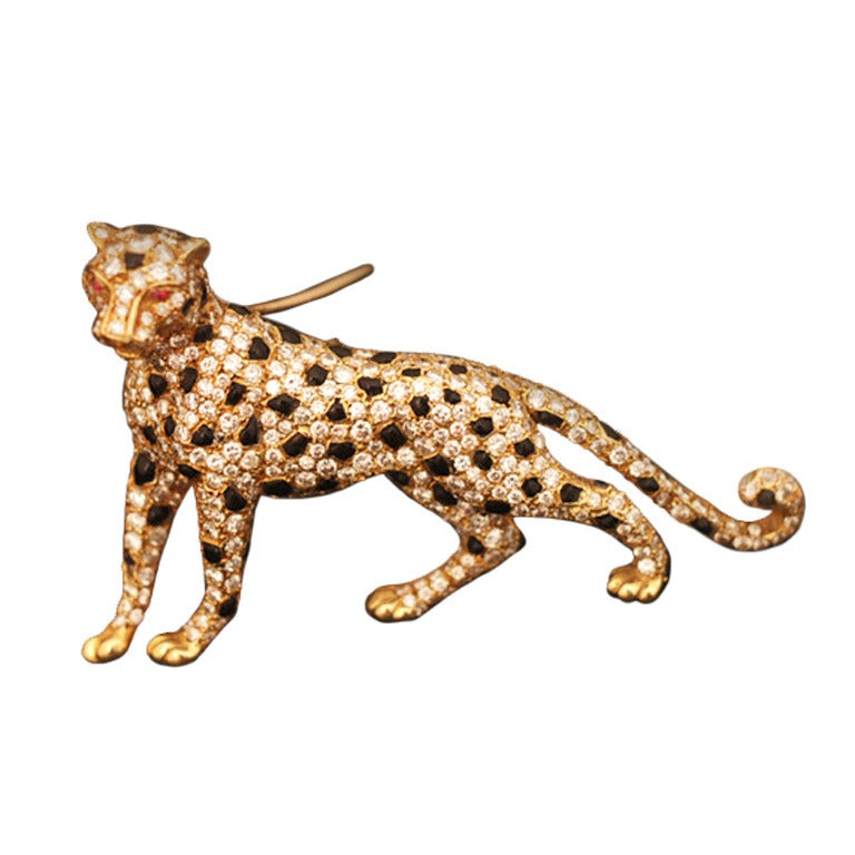 Iconic 1980s Cartier Panther Diamond Onyx Brooch