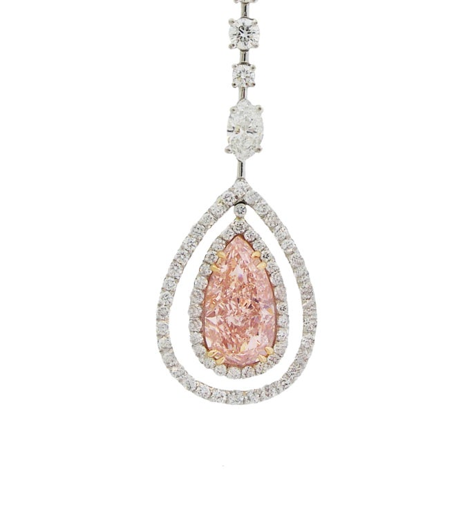 Extraordinary Platinum Necklace with a beautiful 3.16 Carat Natural Pink Pear shape Diamond.  The necklace features Round, Marquise and Pear shape White DIamonds. 12.03 Carats Total.