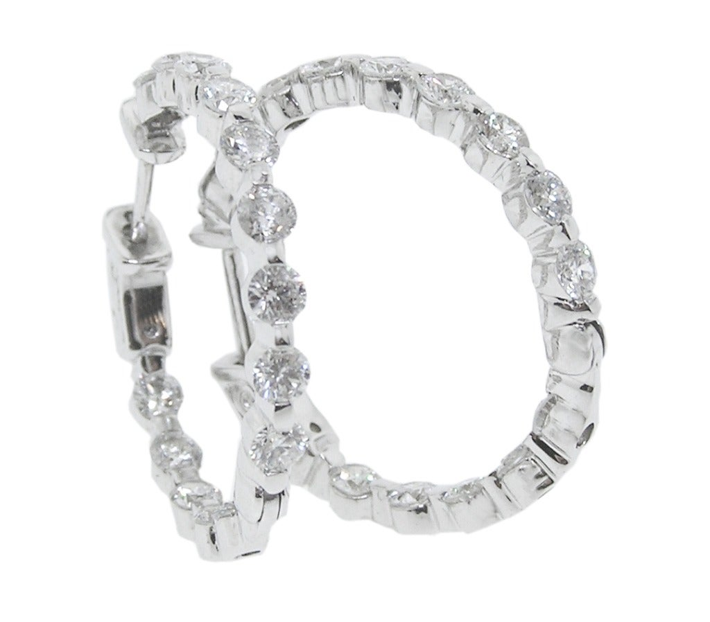 These 14K White Gold Hoops have 2 ½ Carats of high quality Diamonds.  They are set on the outside and inside of the hoops, so when you wear them all you see are Diamonds!  1 inch in diameter.