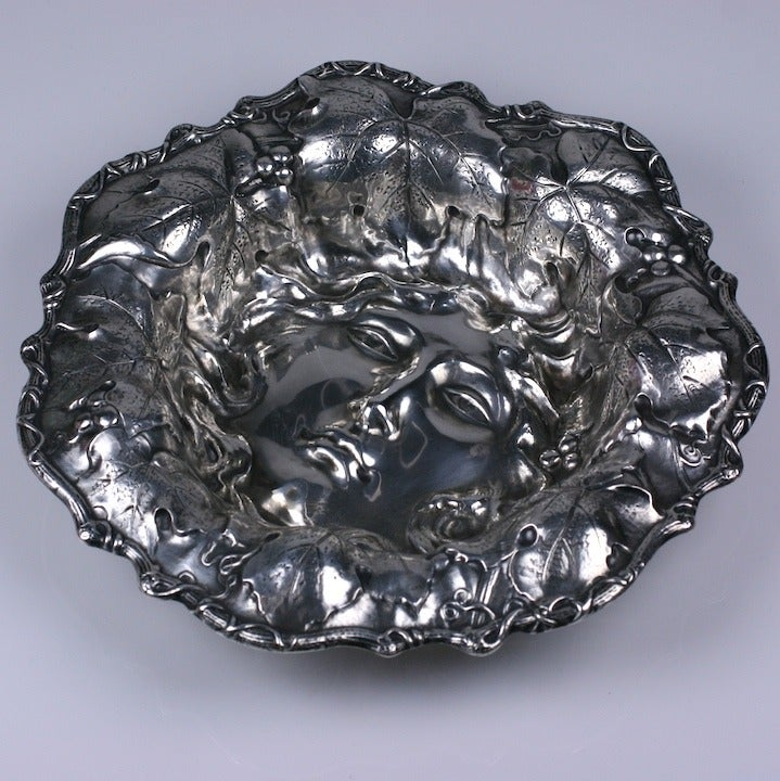 Unusual figural sterling fruit bowl from the early 20th Century. An Art Nouveau maiden's face is centered in the base of the bowl with her hair strewn with leaves and berries in high repousse along the large decorated lip.