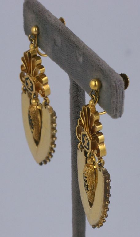 Rare Victorian earrings with mottled and shiny textures. High style urn form pendants with black enamel to match fleur de lis motifs above. Entire earring is articulated to move with wearer. Circa 1870s.<br /> Excellent condition,6cm x 2cm. Screw