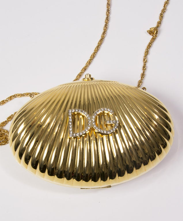 Dolce & Gabbana metal shell clutch with embellished logo 4
