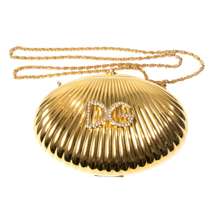 Dolce & Gabbana metal shell clutch with embellished logo 1