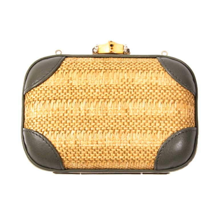 5740dbaf814 Gorgeous petit Gucci clutch with leather and wicker details. The leather  corner patches and strap