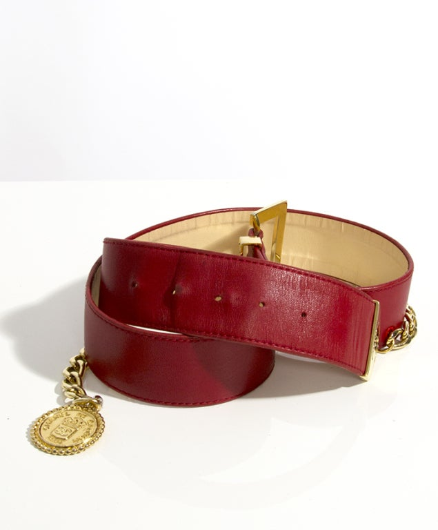 Beautiful Chanel red leather belt with golden chain and medallion. Gold hardware.  Size 80/32  84cm 33
