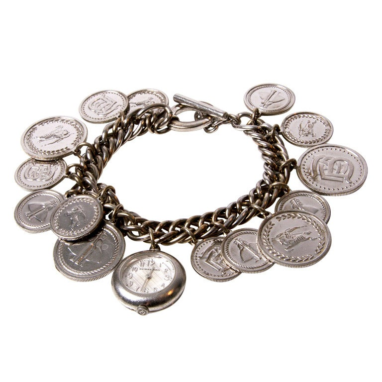 Charm Bracelet Watches: Burberry Lady's Sterling Silver Coin Charm Bracelet Watch