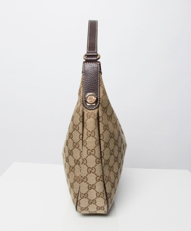 This is an authentic Gucci medium size fabric monogram hobo bag ba1105891169c