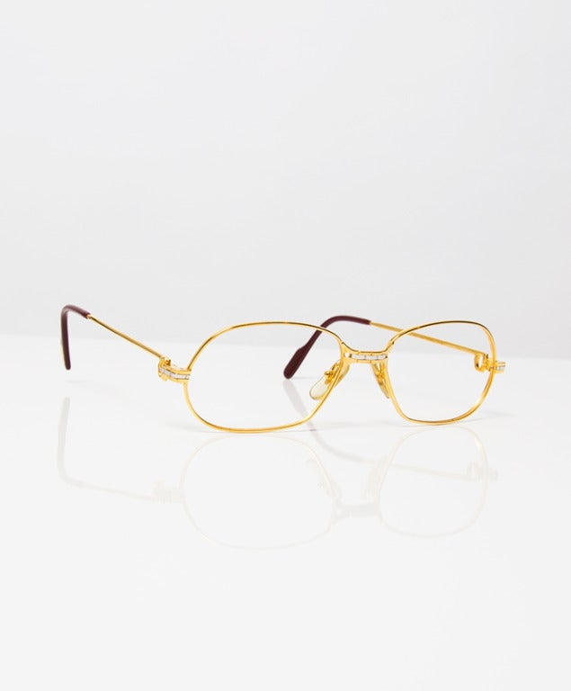 Cartier gold with silver full frame eyeglasses. at 1stdibs