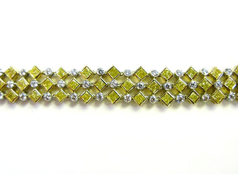 Contemporary 11.15ctw Fancy Yellow and White Diamond Bracelet For Sale