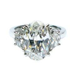 4.62 carat GIA E VS2 Oval and Halfmoon Diamond Ring