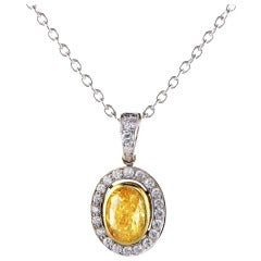 0.74 carats Fancy Vivid Yellow VS1 Diamond Frame Pendant