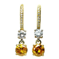 Fancy Vivid Yellow Orange Diamond Earrings