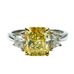 2.01 carat GIA Fancy Yellow Radiant Diamond ring With Trapezoid Cut Diamonds