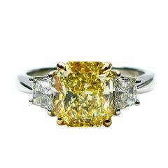 2.01 carat GIA Fancy Yellow Radiant Diamond ring With Trapezoid Cut Diamonds