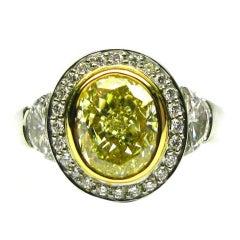 2.07ct GIA Fancy Yellow SI1 Oval Diamond Frame Ring
