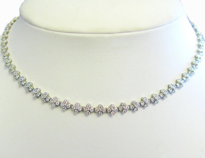 This gorgeous Tiffany & Co. signed platinum diamond necklace is a part of the Lace collection and is perfect for day or night. It's 16