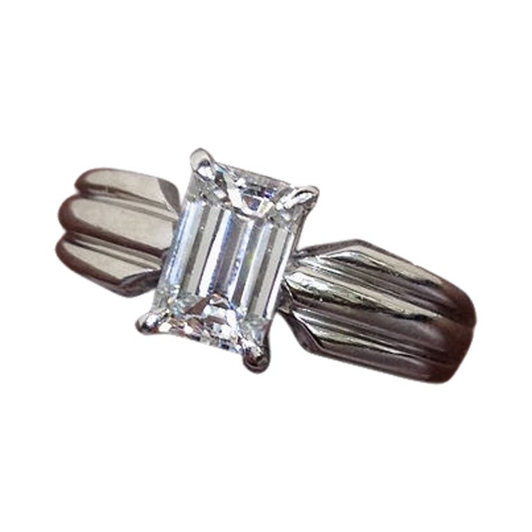 cartier emerald cut engagement ring set in platinum band