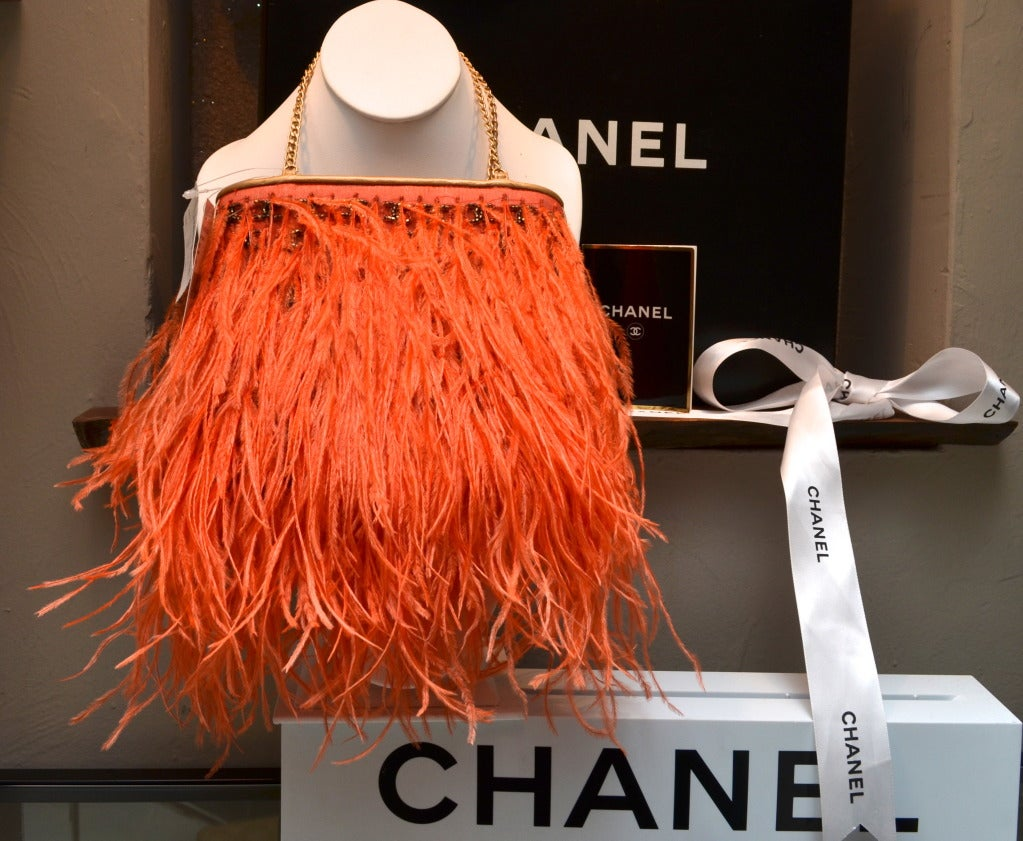 c25a07f615cfa2 Chanel Orange Ostrich Feather Handbag with CC Logo Beading Gold Leather  Lining New Old Stock,