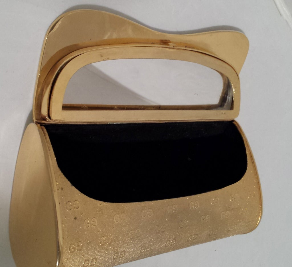 Original rare collectable Gucci gold tone metal minaudière with embossed logo from the 1970's