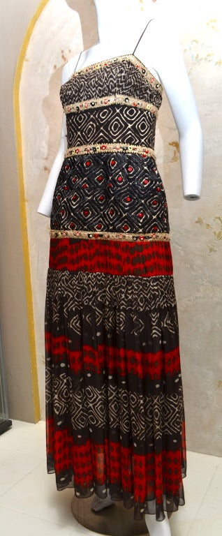 "Oscar De La Renta spring 2008 collection tribal gown with raffia embroidery enamel and netal sequins and chiffon skirt. Measures: 35""bust, 30""waist, 40""Hip, 57"" shoulder to hem