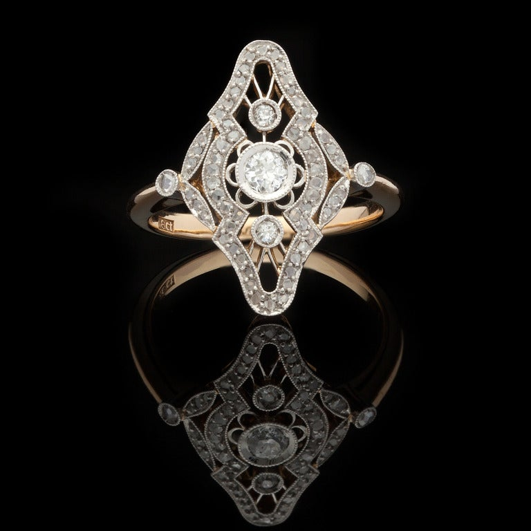 18Kt White & Yellow Gold Vintage Ring with 1 Old Mine Cut Diamond for approximately 0.10cts and an additional 62 Rose Cut Diamonds for approximately 0.20cts, for a total approximate carat weight of 0.30cts with H color and VS clarity.  Ring weighs