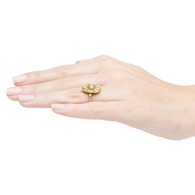 Peachtree II is a gorgeous vintage-inspired Edwardian style engagement ring made from 18k yellow gold featuring a bezel set Old European cut diamond weighing exactly 0.21ct, graded G-H color and VS2 clarity. This sparkly diamond is surrounded by a