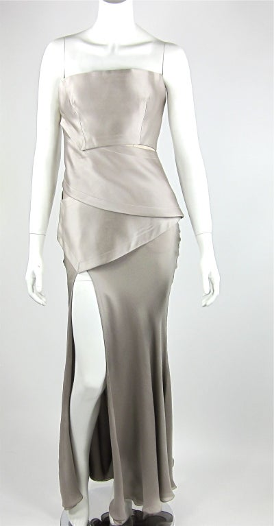 Halston gown in silk charmeuse.  A very architectural look,  the bodice wraps around the body ending in the bias cut skirt with high front slit.  Interior corset. Size: 2