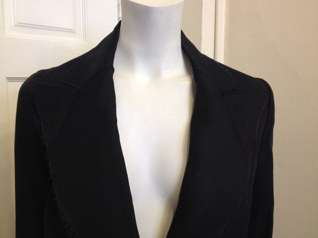 Shabby chic from Lanvin!  This silk blazer is perfect because it is so lightweight and you can put it on over anything.  Raw edges give it a tough finish.  There are two side pockets and a single, satin covered button closes in front. From 2005, we
