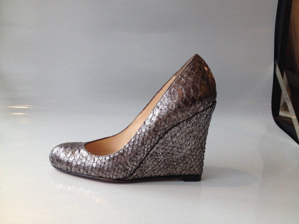 What could be sexier than silver snake skin?  A red sole on the bottom!  The perfect shoe for when you want to make a fabulously subtle statement.  Wear them with slacks, jeans, or a skirt--this pair will look stunning with anything.