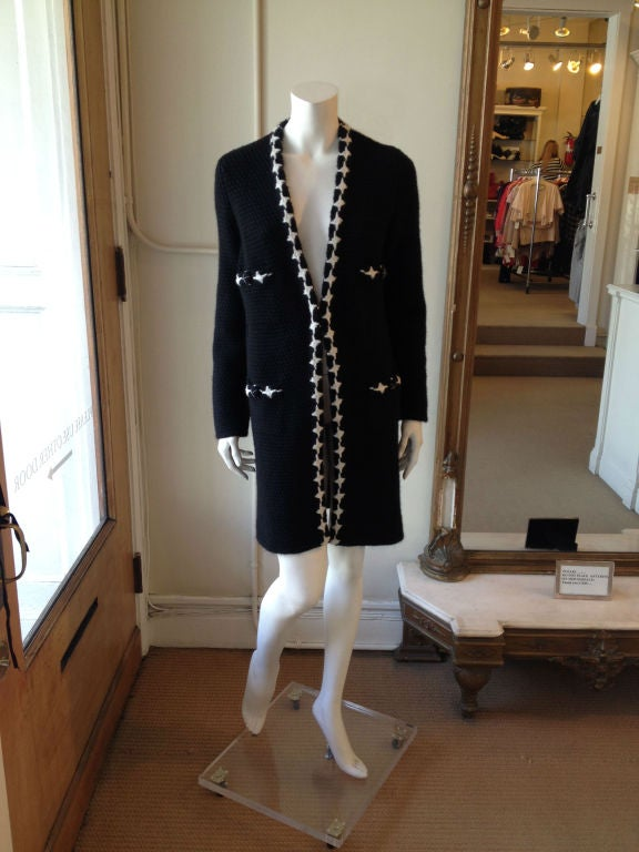 Elegance doesn't have to be hard work - this gorgeous, luxurious, and cozy piece from the fall 2007 collection is so comfortable you won't even realize you're the best dressed lady in the room. Effortlessly chic, with a classic knit houndstooth trim